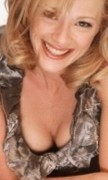 Lauren Holly busty cleavage ... 2 pics