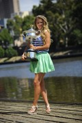 Виктория Азаренко, фото 211. Victoria Azarenka Posing with the Australian Open Trophy along the Yarra River in Melbourne - 29.01.2012, foto 211