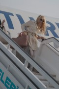Памела Андерсон, фото 4997. Pamela Anderson arrival at Vienna International Airport, march 4, foto 4997